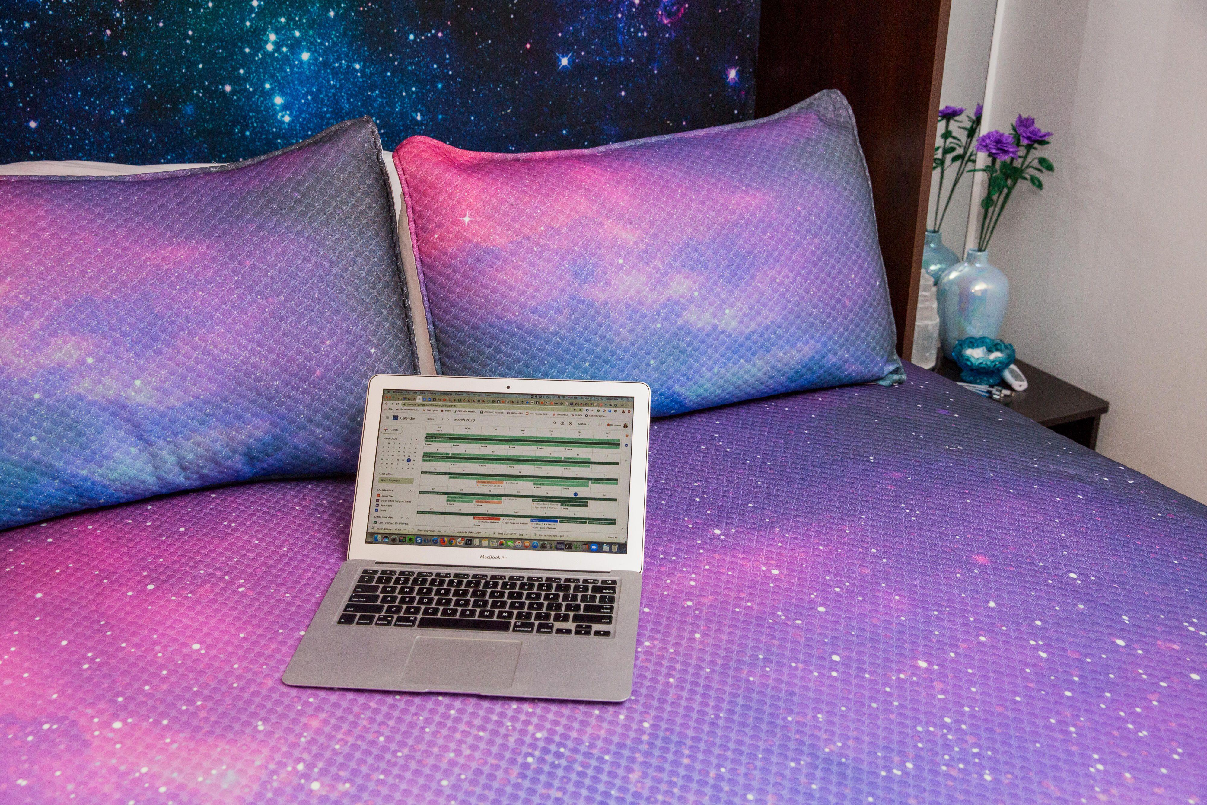 09-work-from-home-laptop-on-bed-coronavirus