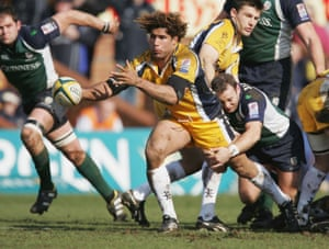 Richard Parks passes the ball out during the Powergen Cup semi-final between Leeds Tykes and London Irish at Headingley in March 2005.