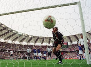 David Seaman watches in horror as Ronaldinho's cross falls into his goal.