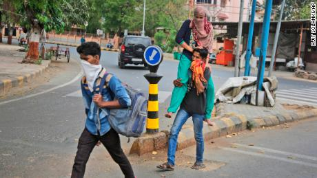 Migrant workers from the state of Rajasthan leaving for their village after the city of Ahmedabad comes under lock down on Thursday, March 26.