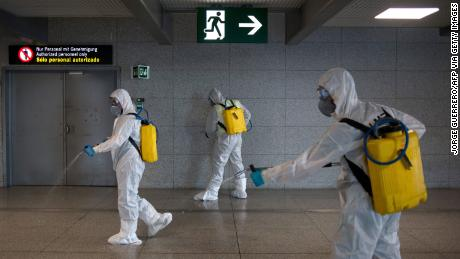 Members of the Military Emergencies Unit (UME) carry out a general disinfection at Malaga airport on March 16, 2020.