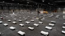 Health workers prepare to receive the first coronavirus patients at Ifema exhibition complex in Madrid on March 22.
