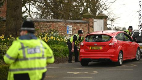 Police officers from North Yorkshire Police stop motorists on Monday to check that their travel is essential.