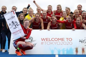 "Great Britain captain Hollie Pearne-Webb holds a scroll reading 'Welcome to Tokyo 2020"" after their victory over Chile Women in November 2019 meant they qualifued for the Tokyo 2020 Olympic games."