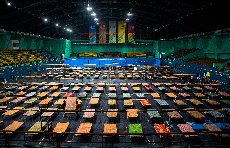 Workers prepare a quarantine center at the Sarusojai sports complex in Gauhati, India, on March 28.