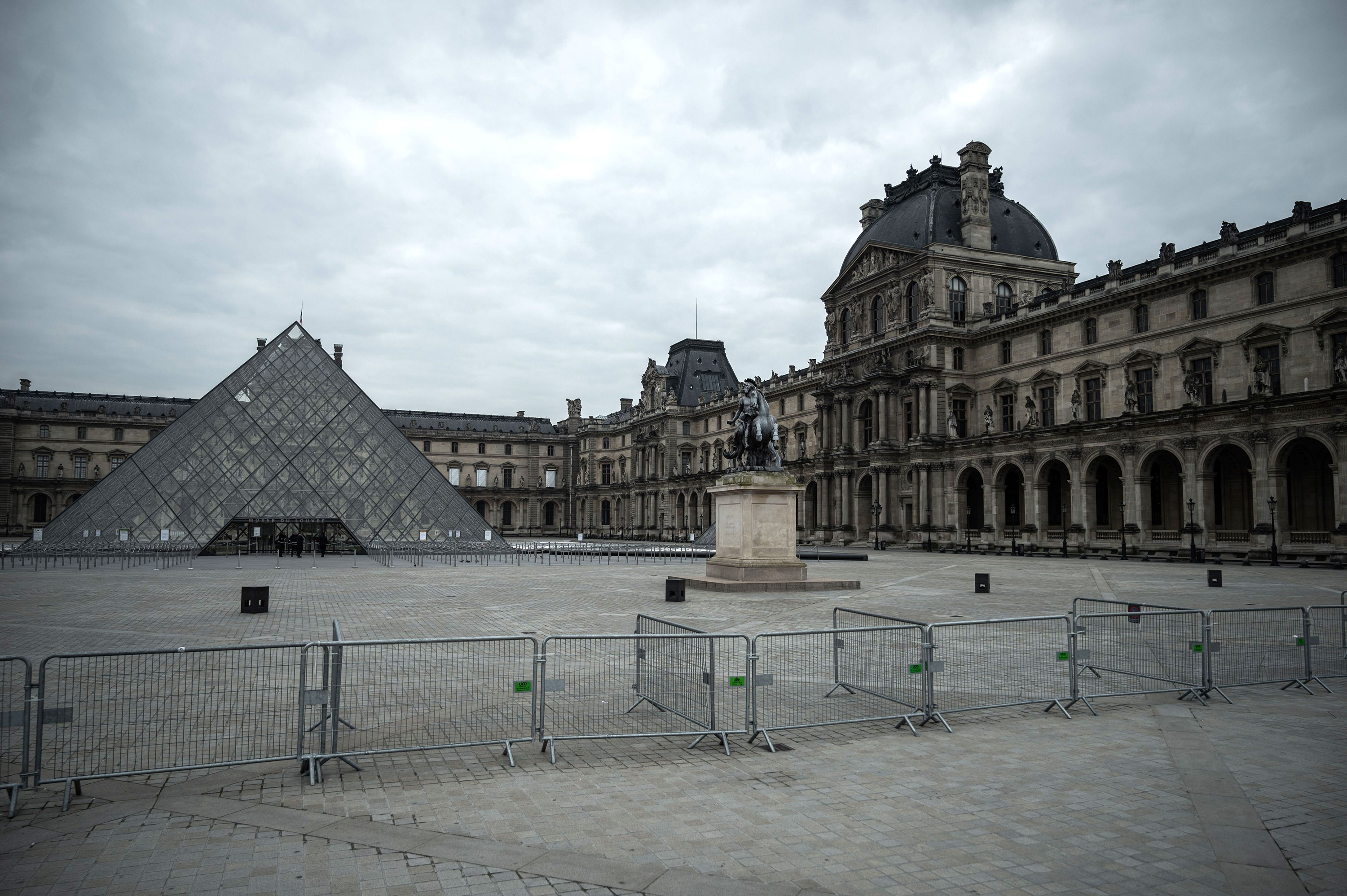The square in front of the pyramid of the Louvre Museum in Paris is empty on March 18.