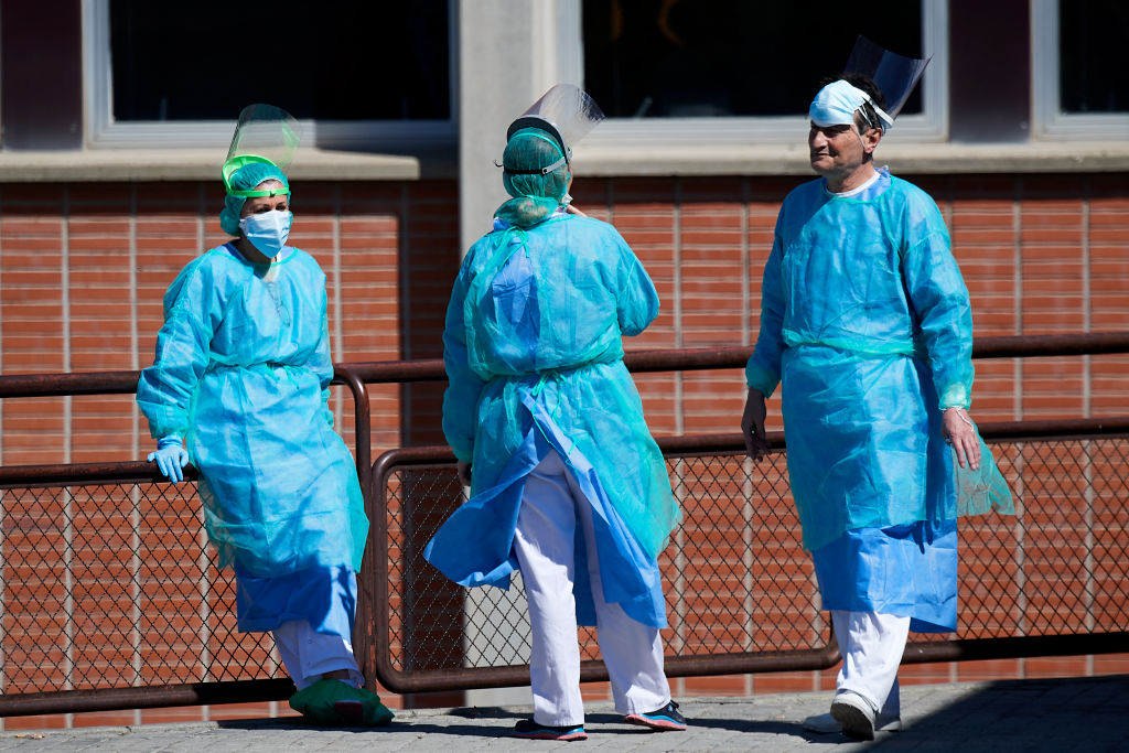 Health personnel outside the emergency entrance of the Severo Ochoa Hospital on March 28, in Madrid, Spain.
