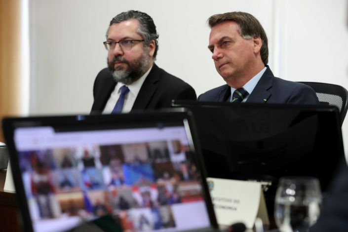 Brazil's President Jair Bolsonaro and Foreign Minister Ernesto Araujo take part in a video link, held by G20 leaders to discuss the coronavirus outbreak and its economic impacts, at the Planalto Palace in Brasilia, Brazil March 26, 2020. Marcos Correa/Brazilian Presidency/Handout via REUTERS ATTENTION EDITORS - THIS IMAGE WAS PROVIDED BY A THIRD PARTY.