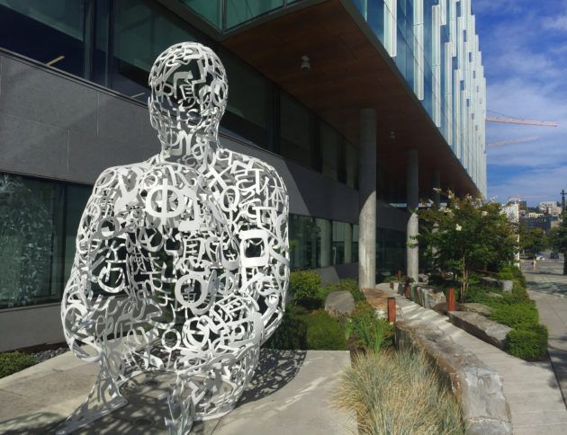 "A sculpture titled ""MIRALL"" stands sentry at the Allen Institute's headquarters in Seattle's South Lake Union district. (GeekWire Photo / Kurt Schlosser)"