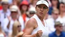 Romania's Simona Halep gives a fist pump after winning a point on the way to taking the opening set against Serena Williams in the women's singles final at Wimbledon.