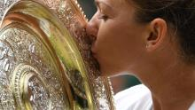 Romania's Simona Halep kisses the Venus Rosewater Dish trophy after beating Serena Williams in the Wimbledon women's singles final.