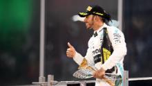 Hamilton celebrates after winning the Abu Dhabi Grand Prix.