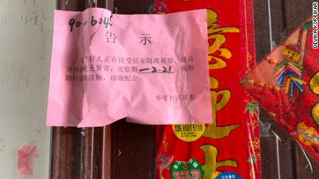 Quarantine seal on the door of the apartment of American teacher Devikka Koppikar in Wuxi, China