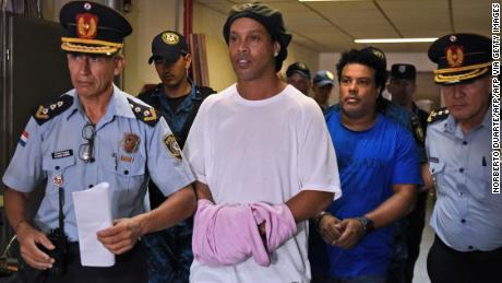 Ronaldinho and his brother Roberto (right) arrive at Asuncion's Justice Palace to appear before a public prosecutor.