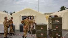 Italian soldiers gather at a military field hospital outside of the main Crema hospital on March 22.