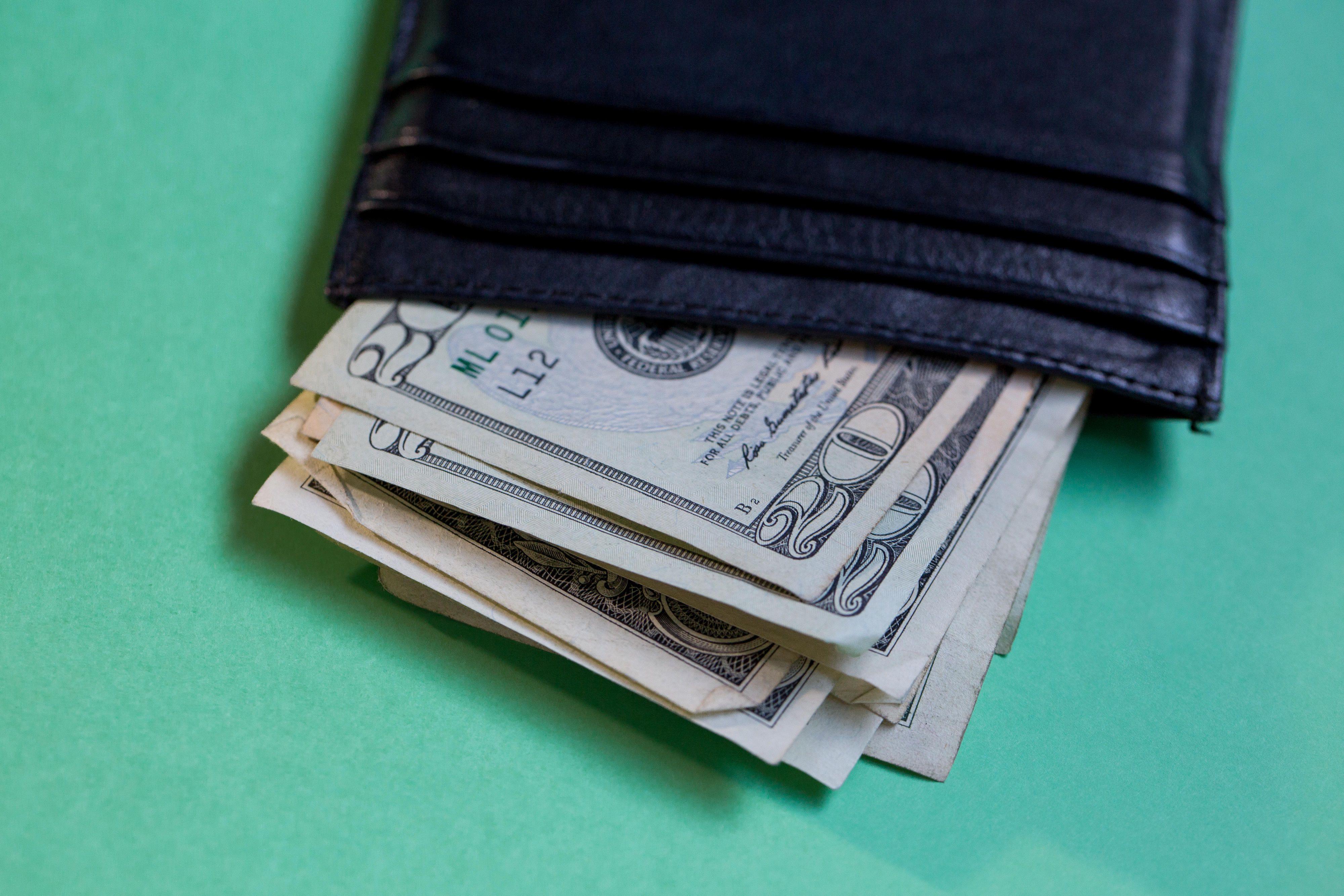 $20 bills in a wallet