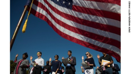 Immigrants take the oath of allegiance to the United States during a naturalization ceremony on September 15, 2017, in Jersey City, New Jersey.