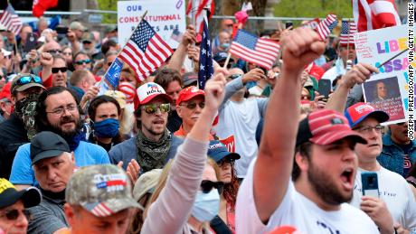 Protesters in Boston rally on May 4 against stay-at-home orders and a law requiring everyone to wear a mask in public.