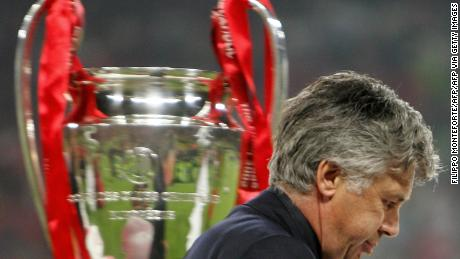 Carlo Ancelotti walks by the throphy at the end of the Champions League final between AC Milan and Liverpool in Istanbul.