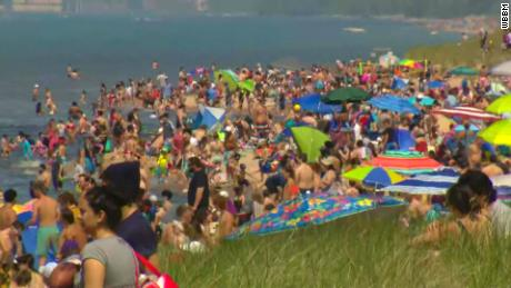 Plenty of people crowded beaches, but social distancing and masks were scarce