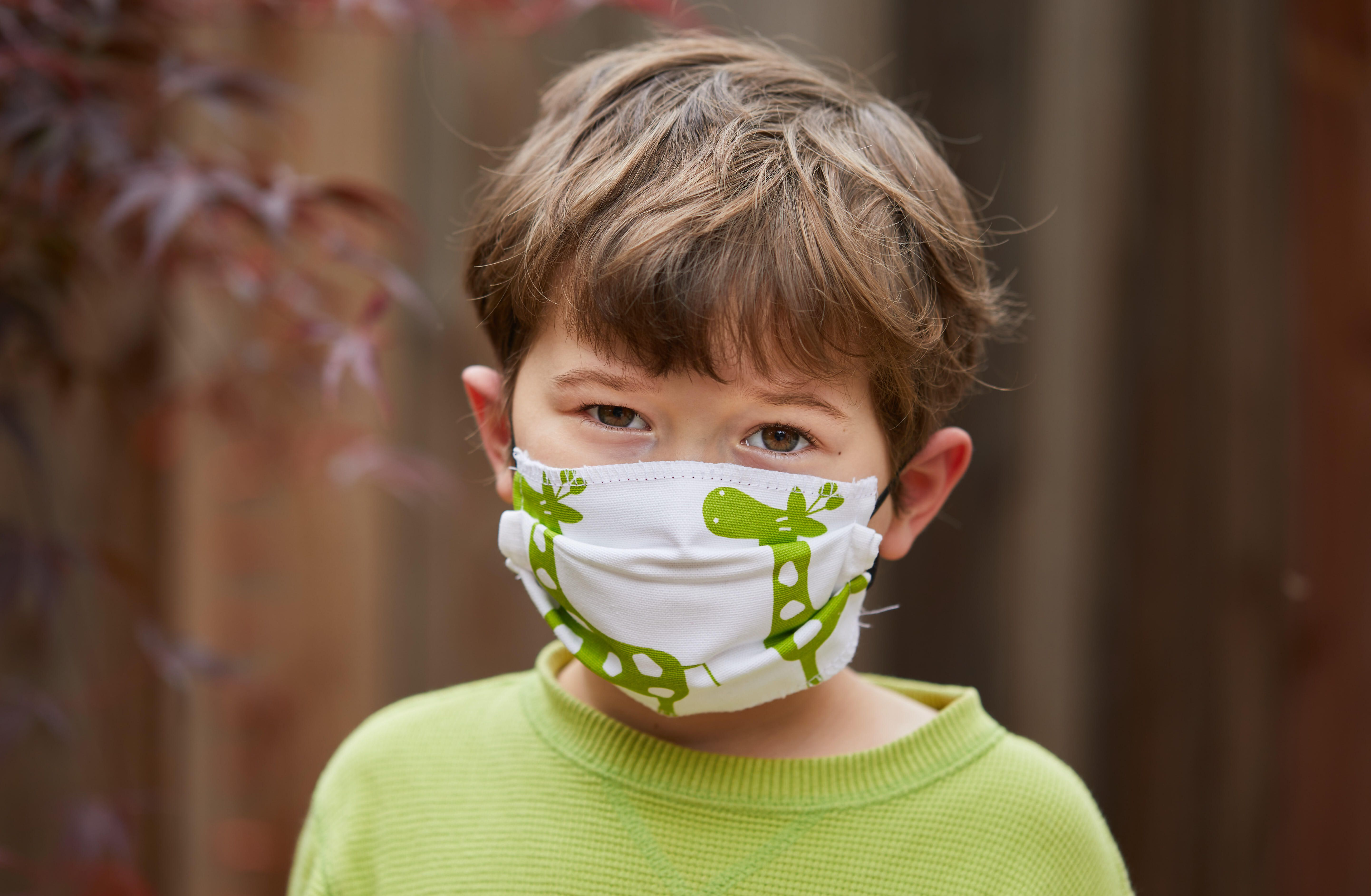 A boy wears a handmade mask to try to reduce transmission of COVID-19, the disease caused by the coronavirus.