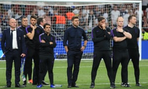 Mauricio Pochettino (centre) looks on after Tottenham lost last year's Champions League final to Liverpool.