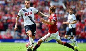 Toby Alderweireld challenges Daley Blind of Manchester United.