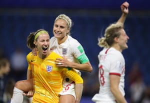 Karen Bardsley carries England teammate Steph Houghton after the Women's World Cup quarter-final victory over Norway.