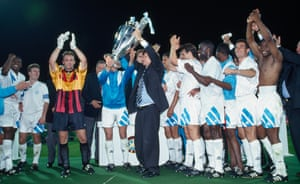 Raymond Goethals lifts the trophy after guiding Marseille to Champions League glory.