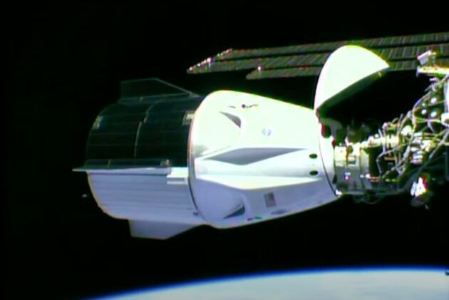 A camera mounted on the International Space Station shows SpaceX's Crew Dragon Endeavour capsule hooked up to a port on the station's Harmony module. (NASA via YouTube)