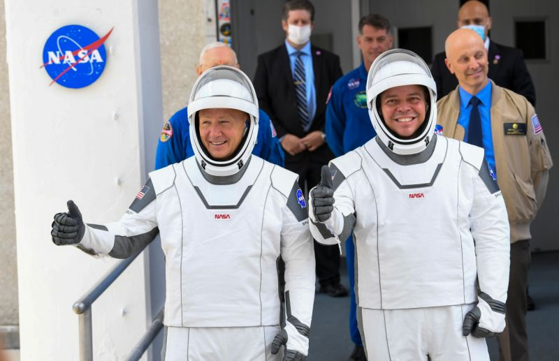 NASA commercial crew astronauts Doug Hurley, left and Bob Behnken, right, leave for their flight aboard the SpaceX Falcon 9 rocket bound for the International Space Station. (Photo: The Washington Post via Getty Images)