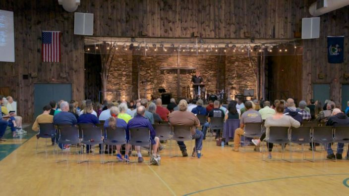 "<div class=""inline-image__caption""> <p>Pastor Ken Graves preaches during an indoor service at Calvary Chapel in Orrington, Maine, May 24. The service was held in defiance of Maine Gov. Janet Mills' order that churches not reopen until May 29 and then only if they limit gatherings to 50 people or less and everyone wears a face mask.</p> </div> <div class=""inline-image__credit""> Johanna S. Billings </div>"