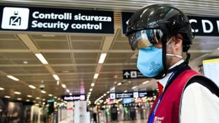 Image shows a Fiumicino airport employee wearing a
