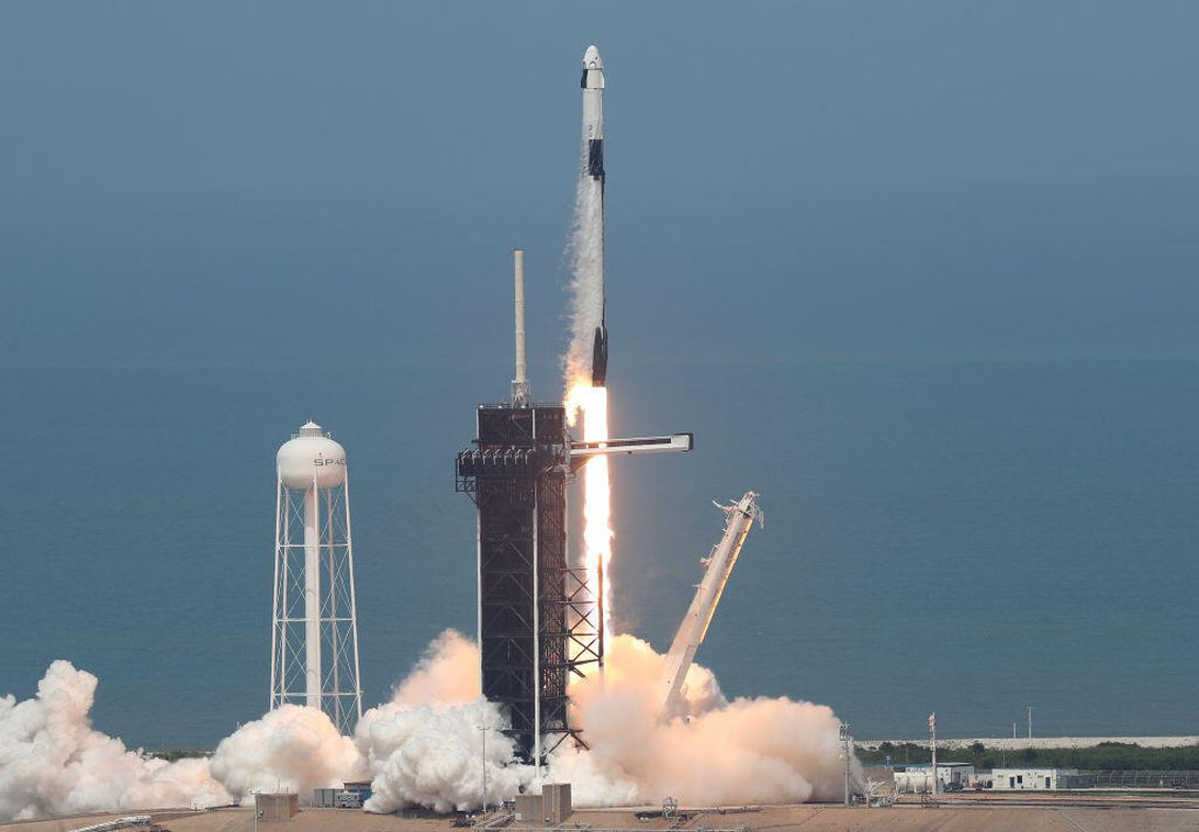 The SpaceX Falcon 9 rocket with the manned Crew Dragon spacecraft attached takes off from launch pad 39A at the Kennedy Space Center.