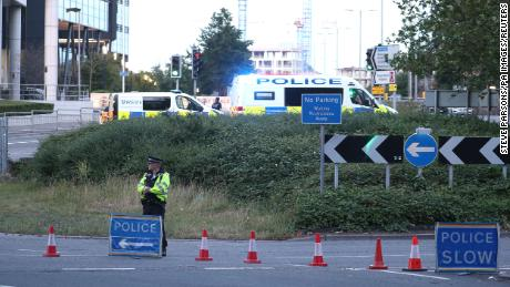 Officers near Forbury Gardens in Reading, England, where police responded to a stabbing incident on Saturday, June 20, 2020.