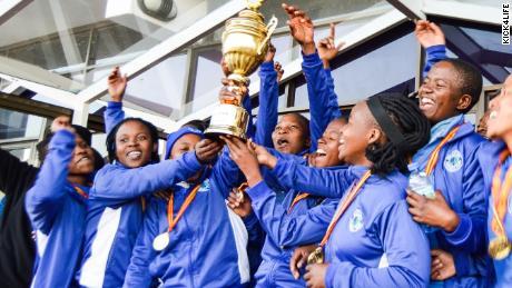The women's team celebrate winning Kick4Life FC's first major trophy.