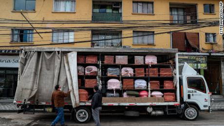 Coffins are brought to a funeral store in Santiago, Chile, on June 19, during the new coronavirus pandemic.