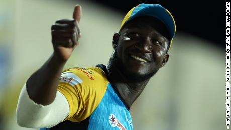 Sammy gives a thumbs up to the crowd while he plays for the St Lucia Stars.