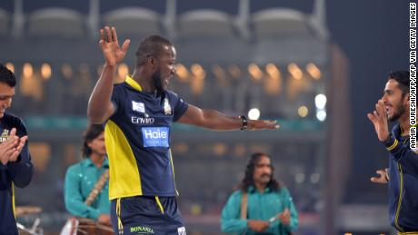 Sammy dances with teammates on a stage prior to the start of the final cricket match of the Pakistan Super League.