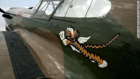 "A World War II-era P-40 Warhawk, painted in the colors of the American Volunteer Group the ""Flying Tigers"" is on display in Oshkosh, Wisconsin, in 2007."