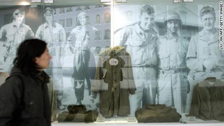 A visitor walks past images and old uniforms of the Flying Tigers at the Anti-Japanese War Museum in Dayi county in China's Sichuan province in 2005.