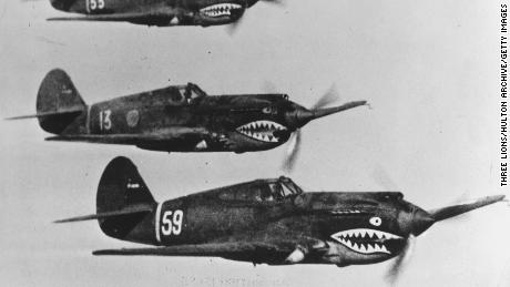 American Volunteer Group aircraft flying in tight formation during World War II.