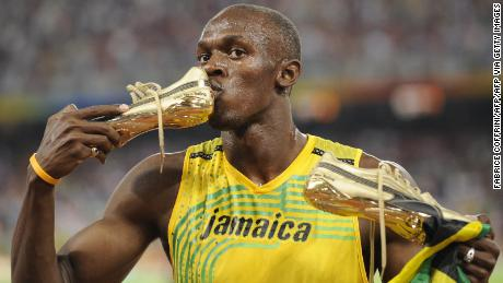 Jamaica's Usain Bolt kisses his shoe after winning the men's 100m final at the National stadium as part of the 2008 Beijing Olympic Games on August 16, 2008.
