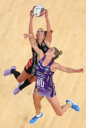 Kelsey Browne of the Magpies and Gabi Simpson of the Firebirds compete for the ball during the round 9 Super Netball match between the Magpies and the Firebirds at Melbourne Arena on June 23, 2019 in Melbourne, Australia.