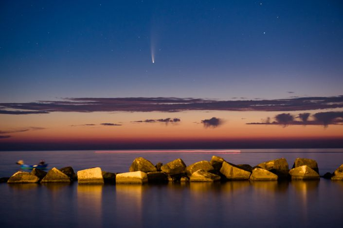 Comet Neowise shining at sunset above the Port of Molfetta in Molfetta on July 11, 2020. / Credit: Davide Pischettola/NurPhoto via Getty Image
