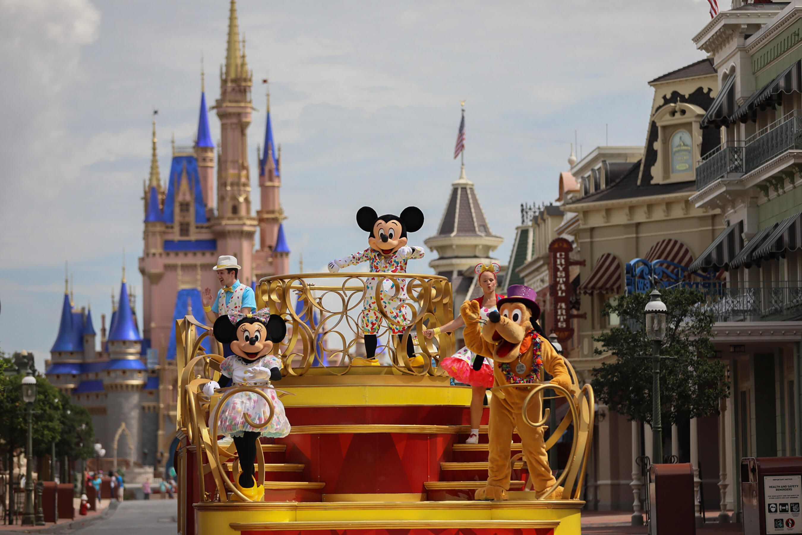 Disney World reopening guests face masks Mickey cavalcade