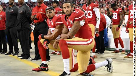 Colin Kaepernick kneels in protest during the National Anthem in 2016.