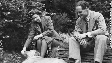 RAF flying ace Douglas Bader  in the garden of his home in Ascot, Berkshire, with his wife, Thelma, after his release from a German prisoner-of-war camp in 1945.