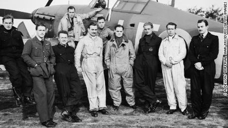 Squadron Leader Douglas Bader, front center fourth from right,  stands beside his Hawker Hurricane Mk1 with the men of Royal Air Force No. 242 Squadron during the Battle of Britain in early September 1940 at RAF Duxford near Cambridge, England.