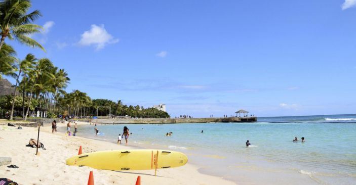 "Fewer than usual people are seen at Waikiki Beach in Honolulu, Hawaii, on July 29, 2020, amid the novel coronavirus outbreak. <p class=""copyright"">Kyodo News via Getty Images</p>"